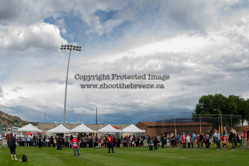 KELOWNA, CANADA - JUNE 28: Fans get autographs during the opening charity game of the Home Base Slo-Pitch Tournament fundraiser for the Kelowna General Hospital Foundation JoeAnna's House on June 28, 2019 at Elk's Stadium in Kelowna, British Columbia, Canada.  (Photo by Marissa Baecker/Shoot the Breeze)
