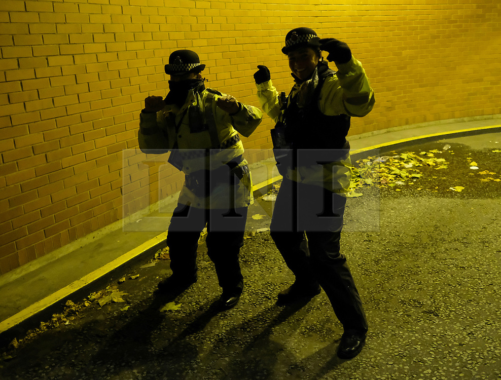 (c) Licensed to London News Pictures. <br /> 03/10/2017<br /> Manchester, UK<br /> <br /> Two policewomen dance to keep warm in an underground carpark at the Conservative Party Conference held at the Manchester Central Convention Complex.<br /> <br /> Photo Credit: Ian Forsyth/LNP