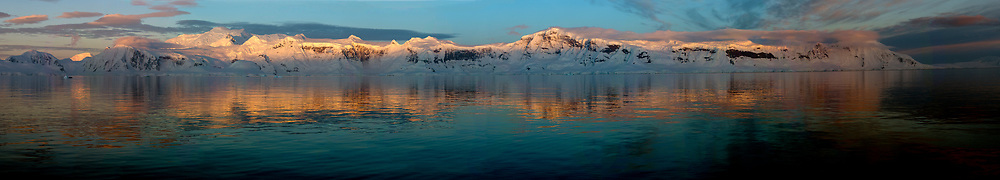 Panorama of the sunrize on Anvers Island in Gerlache Strait, the Antarctic Peninsula.