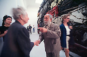 VENICE, ITALY..June 1995..46th Biennale of Venice.French Pavillion..Ce?sar greeting friend in front of one of his sculptures..(Photo by Heimo Aga)
