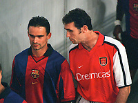 Martin Keown (Arsenal) has a word with his former team mate Marc Overmars (Barcelona). Arsenal v FC Barcelona, The Amsterdam Tournament, Amsterdam Arena, Holland, 3/8/2000. Credit Colorsport / Stuart MacFarlane.