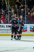 KELOWNA, CANADA - DECEMBER 1: Mark Liwiski #9 is hugged by Lassi Thomson #2 and Conner Bruggen-Cate #20 of the Kelowna Rockets after scoring the teddy bear toss triggering goal against the Saskatoon Blades on December 1, 2018 at Prospera Place in Kelowna, British Columbia, Canada.  (Photo by Marissa Baecker/Shoot the Breeze)