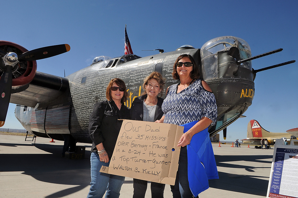 jt040517e/a sec/jim thompson/ left to right- In memory of their father Walton B. Kelly,Leslie Kelly Hutz, Linda Kelly Goff and Tracy Kelly Kapple stand with a Consolidated B-24J Liberator at the Cutter Aviation as part of the Wings of Freedom Tour is in Albuquerque Wednesday April 5th-7th.  April 05, 2017. (Jim Thompson/Albuquerque Journal)