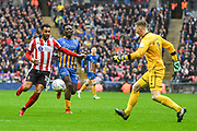 Dean Henderson of Shrewsbury Town (1) clears the ball from Matt Green of Lincoln City (10) during the EFL Trophy Final match between Lincoln City and Shrewsbury Town at Wembley Stadium, London, England on 8 April 2018. Picture by Stephen Wright.