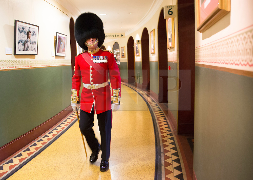 © Licensed to London News Pictures. 07/11/2014.  London.  A soldiers makes his way to the auditorium ahead of today's Festival of Remembrance.  First broadcast in 1927 the festival has now been held in the Royal Albert Hall for 87 years.  Photo credit : Alison Baskerville/LNP
