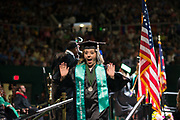 Kendra Lutes celebrates during undergraduate commencement ceremonies. Photo by Ben Siegel