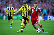 (L) Lukasz Piszczek of Dortmund fights for the ball with (R) Franck Ribery of Monachium during the UEFA Champions League Final football match between Borussia Dortmund and Bayern Munich at Wembley Stadium in London on May 25, 2013...England, London, May 25, 2013..Picture also available in RAW (NEF) or TIFF format on special request...For editorial use only. Any commercial or promotional use requires permission...Photo by © Adam Nurkiewicz / Mediasport