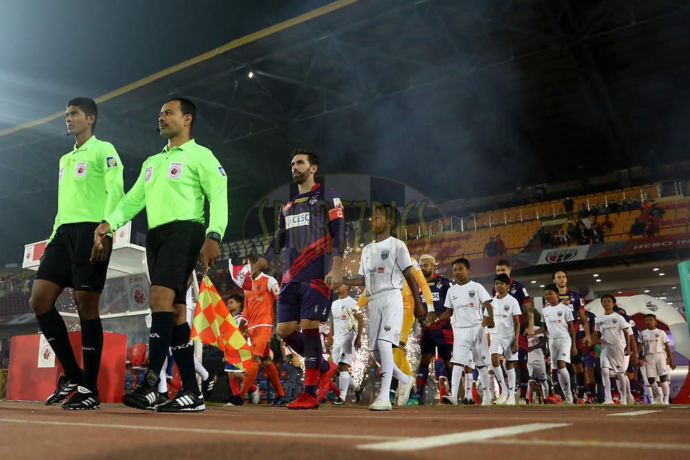 Players entering on the field with children escorts during match 45 of the Hero Indian Super League between NorthEast United FC and ATK  held at the Indira Gandhi Athletic Stadium, Guwahati India on the 12th January 2018<br /> <br /> Photo by: Arjun Singh  / ISL / SPORTZPICS