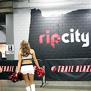 Cheerleaders enter the Moda Center arena while the Portland Trailblazers host the Golden State Warriors in an National Basketball Association game in Portland, Ore.