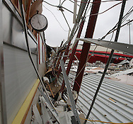 A clock in the gym of Aplington-Parkersburg High School shows the time the tornado hit the school in Parkersburg, Iowa on Wednesday June 4, 2008. (Stephen Mally for the New York Times)