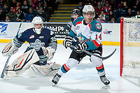 KELOWNA, CANADA -FEBRUARY 10: Taran Kozun #35 of the Seattle Thunderbirds defends the net and looks for the pass to Rourke Chartier #14 of the Kelowna Rockets during the first period on February 10, 2014 at Prospera Place in Kelowna, British Columbia, Canada.   (Photo by Marissa Baecker/Getty Images)  *** Local Caption *** Taran Kozun; Rourke Chartier;
