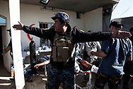 Iraq, Mosul: Foreign and Iraqi doctors treating heavy injured Iraqi soldiers at a field first aid clinic in the west-southern outskirts of Mosul. Alessio Romenzi
