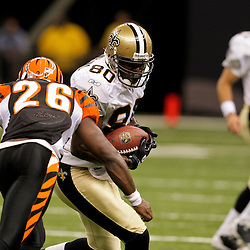 2009 August 14: New Orleans Saints tight end Darnell Dinkins (80) is hit by Cincinnati Bengals safety Marvin White (26) after a catch during 17-7 win by the New Orleans Saints over the Cincinnati Bengals in their preseason opener at the Louisiana Superdome in New Orleans, Louisiana.