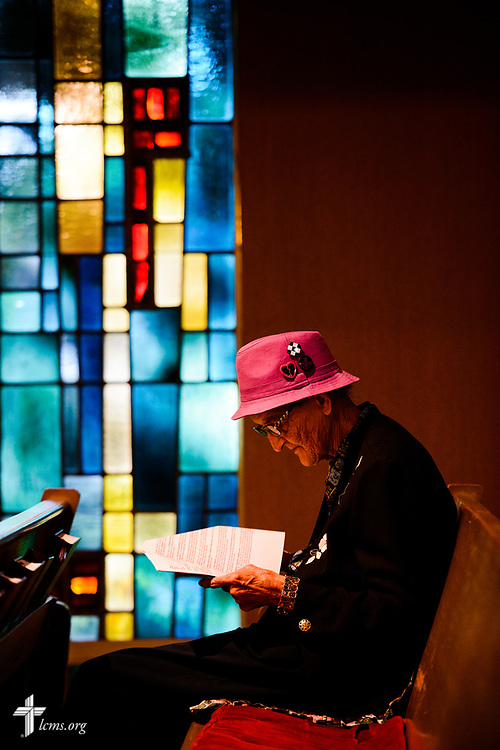 Virginia Schaefer reads the bulletin before Divine Service at Mt. Calvary Lutheran Church, La Grange, Texas, on Sunday, Sept. 3, 2017. Last week, only a handful of church members who weren't trapped by the floodwaters made it to worship. A week after Hurricane Harvey the pews filled up again after the waters receded. LCMS Communications/Erik M. Lunsford