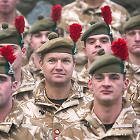The Black Watch Homecoming Parade, Aberfeldy....10.12.09<br /> Lt Col Stephen Cartwright CO of the Black Watch poses for a photograph with his soldiers by the Black Watch memorial in Aberfeldy after parading through the town on their return from Afghanistan......Aberfeldy is where the 'Companies' of men were mustered in 1667, the dark tartans that the men wore to distinguish them from the 'Red Soldiers' led them to becoming known as 'Freiceadan Dubh' or 'The Black Watch'<br /> Picture by Graeme Hart.<br /> Copyright Perthshire Picture Agency<br /> Tel: 01738 623350  Mobile: 07990 594431