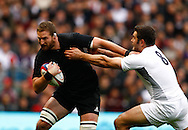Nick Easter of England tackles Kieran Read of New Zealand during the Investec series international between England and the New Zealand All Blacks at Twickenham, London, Looks on Saturday 6th November 2010. (Photo by Andrew Tobin/SLIK images)