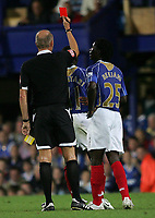 Photo: Lee Earle.<br /> Portsmouth v Manchester United. The FA Barclays Premiership. 15/08/2007.Portsmouth's Sulley Muntari is shown the red card by the ref.