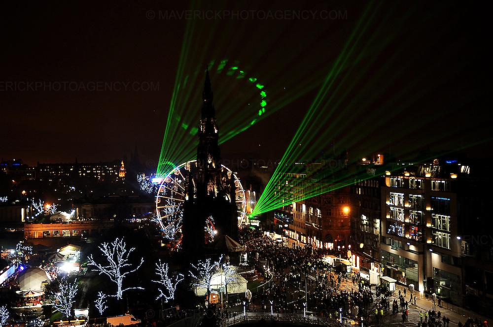 EDINBURGH, UK. Revellers hit Princes Street in Edinburgh leading up to the new year celebrations.