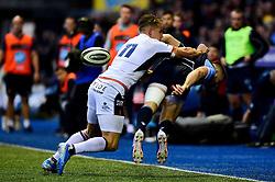 Duhan van der Merwe of Edinburgh Rugby puts ,Owen Lane of Cardiff Blues into touch as he offloads the ball - Mandatory by-line: Ryan Hiscott/JMP - 05/10/2019 - RUGBY - Cardiff Arms Park - Cardiff, Wales - Cardiff Blues v Edinburgh Rugby - Guinness Pro 14