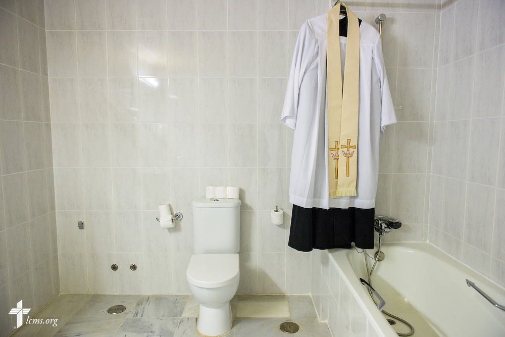 An alb hangs before worship in the bathroom-turned-sacristy at a makeshift hotel space on Sunday, Nov. 6, 2016, in Seville, Spain.  LCMS Communications/Erik M. Lunsford