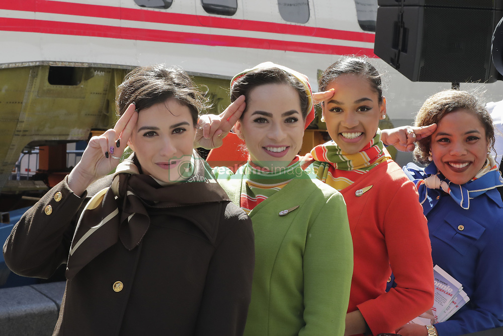 March 23, 2019 - New York, NY, USA - Times Square, New York, USA, March 23, 2019 - Actors dressed as pilots, flight attendants and mechanics from the 1960s and 70s helps celebrate the TWA Hotel Project, including the restoration of the 1958 Lockheed Constellation plane Connie today in Times Square, Manhattan.Photo: Luiz Rampelotto/EuropaNewswire (Credit Image: © Luiz Rampelotto/ZUMA Wire)