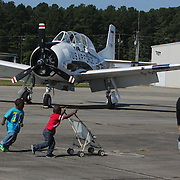People walk past a U.S. Air Force jet during Aviation Day Saturday October 11, 2014 at Wilmington International Airport in Wilmington, N.C. (Jason A. Frizzelle)