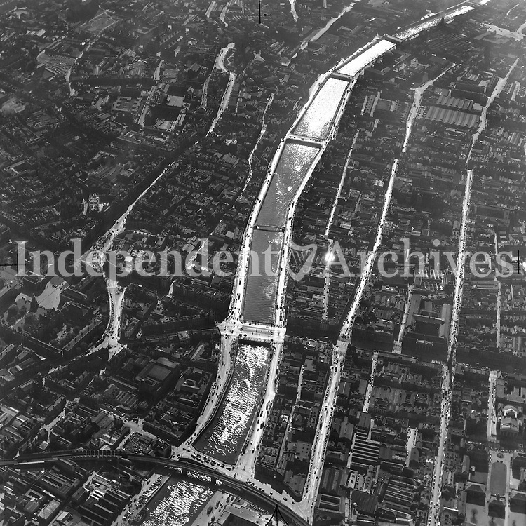 A171 Dublin aerial including T.C.D.   24/05/51. (Part of the Independent Newspapers Ireland/NLI collection.)<br /> <br /> <br /> These aerial views of Ireland from the Morgan Collection were taken during the mid-1950's, comprising medium and low altitude black-and-white birds-eye views of places and events, many of which were commissioned by clients. From 1951 to 1958 a different aerial picture was published each Friday in the Irish Independent in a series called, 'Views from the Air'.<br /> The photographer was Alexander 'Monkey' Campbell Morgan (1919-1958). Born in London and part of the Royal Artillery Air Corps, on leaving the army he started Aerophotos in Ireland. He was killed when, on business, his plane crashed flying from Shannon.