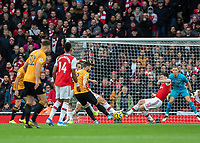 Football - 2019 / 2020 Premier League - Arsenal vs. Wolverhampton Wanderers<br /> <br /> Matt Doherty (Wolverhampton Wanderers) strikes towards the Arsenal goal at The Emirates Stadium.<br /> <br /> COLORSPORT/DANIEL BEARHAM
