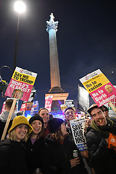 © Licensed to London News Pictures. 03/12/2019. London, UK. Protesters conclude a day of demonstration opposing Trump's UK visit as he attended NATO's 70th anniversary in an Counter-Trump rave in the middle of Trafalgar Square. Donald Trump who visited Buckingham Palace earlier in the evening was driven away along a route avoiding contact with the protests. Photo credit: Guilhem Baker/LNP