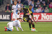 28 Mar 2016: Rolieny Ronevacia of the Wellington Phoenix controls the ball in front of Anthony Caceres of Melbourne City during the 25th round of the 2015-16 Hyundai A-League Season between Melbourne City and Wellington Phoenix held at AAMI Park, VIC, Australia. (Photo by Jason Heidrich/Icon Sportswire)