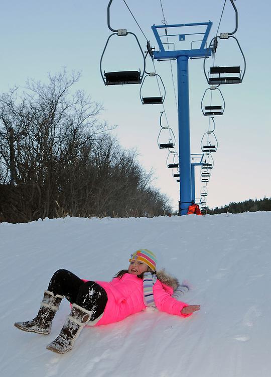 jt122116a/a sec/jim thompson/ Karla Villa -8 slides on her back down a embankment near the chair lift at the Sandia Ski area.  Wednesday Dec. 21, 2016. (Jim Thompson/Albuquerque Journal)