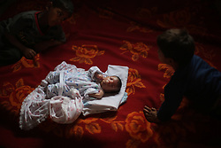59613448  .Rezik Sobih, a 40-day-year old baby suffering from cancer, lies in the bed in the northern Gaza Strip town of Beit Lahiya on May 7, 2013. An increasing number of Gazan families were reportedly falling further into poverty, with unemployment rate at over 30% according to 2012 estimates, May 7, 2013. Photo by:  imago / i-Images.UK ONLY