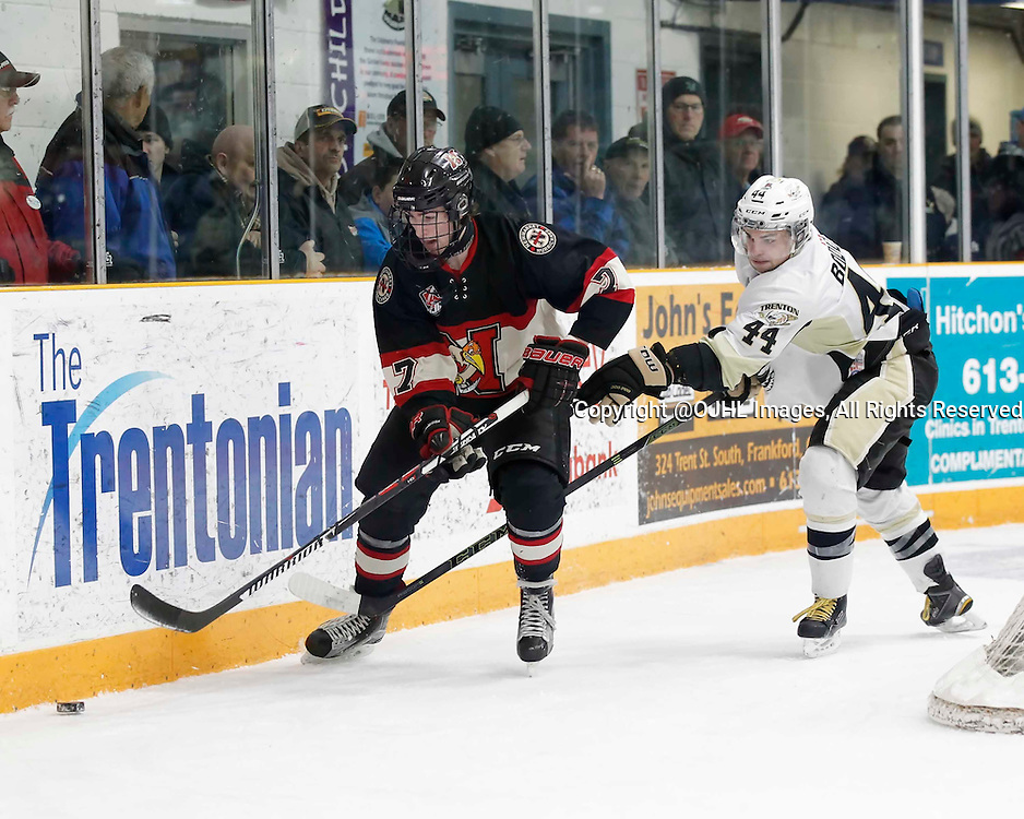 TRENTON, - Mar 1, 2016 -  Ontario Junior Hockey League game action between the Trenton Golden Hawks and the Newmarket Hurricanes. Game 1 of the first round playoff series at the Duncan Memorial Gardens, ON, Max Routledge #7 of the Newmarket Hurricanes and Chays Ruddy #4 of the Trenton Golden Hawks battle for the puck during the second period<br />  (Photo by Amy Deroche / OJHL Images)