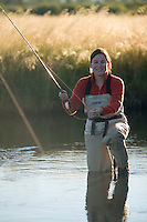 Sarah Meredith fly fishing small meadow stream near Lake Tahoe, CA.