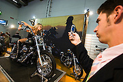 The 61. IAA (Internationale Autoausstellung) 2005 is one of the World's biggest trade fairs of the automotive industry..Vrrroooommm: Harley Davidson Bikes and girls.