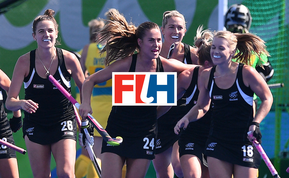 New Zealand's players celebrate their opening goal during the the women's quarterfinal field hockey New Zealand vs Australia match of the Rio 2016 Olympics Games at the Olympic Hockey Centre in Rio de Janeiro on August 15, 2016. / AFP / Carl DE SOUZA        (Photo credit should read CARL DE SOUZA/AFP/Getty Images)