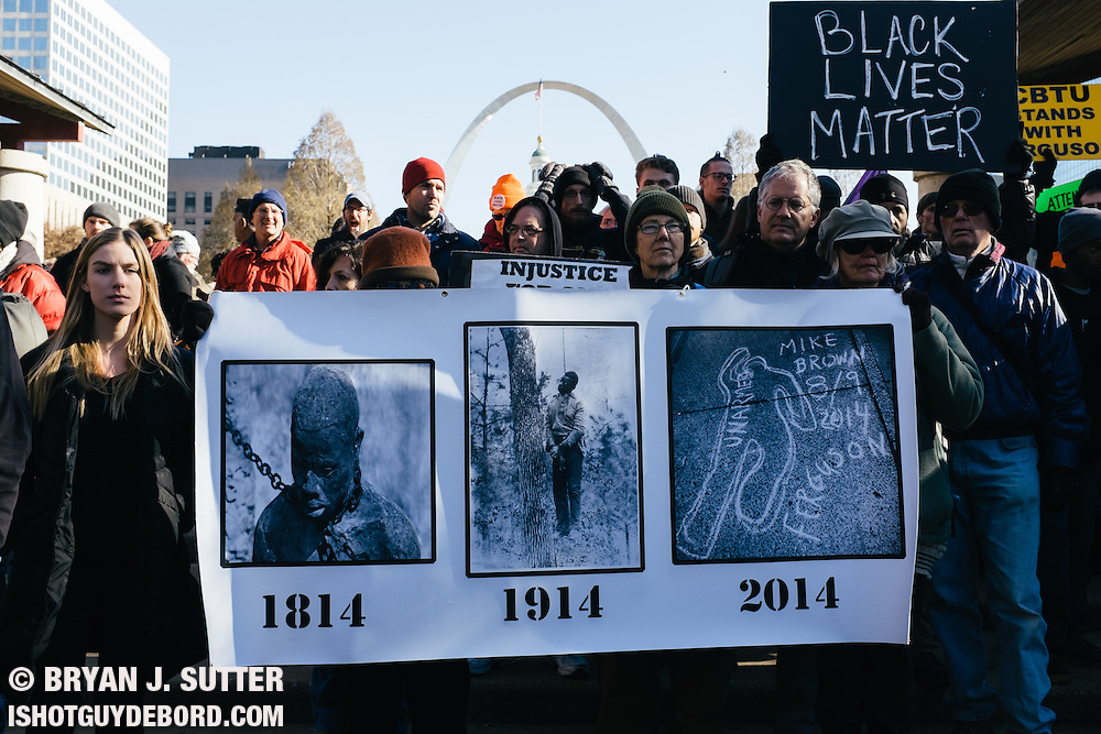 Hundreds gather at Kiener Plaza in downtown St. Louis on November 25, 2014 to protest the grand jury finding no cause to indict Darren Wilson for the death of Mike Brown.