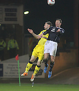 Iain Davidson wins a header - Dundee  v Queen of the South - SPFL Championship at Dens Park<br /> <br />  - &copy; David Young - www.davidyoungphoto.co.uk - email: davidyoungphoto@gmail.com