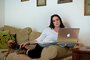 Aaron Leigh Johnson-Horton, founder of The Mesh Warrior, works on her blog at her home in Dallas, Texas on July 8, 2014. (Cooper Neill for The Texas Tribune)
