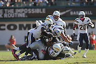 OAKLAND, CA - OCTOBER 10: Michael Bush #29 of the Oakland Raiders is tackled by players of the San Diego Chargers at Oakland-Alameda County Coliseum on October 10, 2010 in Oakland, California. (Photo by Tom Hauck) Player:  Michael Bush