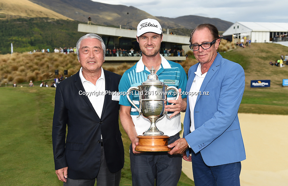 Australia's Matthew Griffin with the Brodie Breeze trophy with Sir Michael Hill (R) and Mr Ishii of Millbrook resort after winning the NZ Open at The Hills during 2016 BMW ISPS Handa New Zealand Open. Sunday 13 March 2016. Arrowtown, New Zealand. Copyright photo: Andrew Cornaga / www.photosport.nz