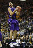 January 12 2010: Northwestern Wildcats guard/forward Drew Crawford (1) pulls down a rebound during the first half of an NCAA college basketball game at Carver-Hawkeye Arena in Iowa City, Iowa on January 12, 2010. Northwestern defeated Iowa 90-71.