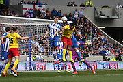Brighton's Dale Stephens jumps with Watford's Troy Deeney during the Sky Bet Championship match between Brighton and Hove Albion and Watford at the American Express Community Stadium, Brighton and Hove, England on 25 April 2015. Photo by Geoff Penn.