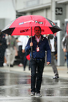 Martin Brundle (GBR) Sky Sports Commentator in a wet and rainy paddock.<br /> Japanese Grand Prix, Sunday 5th October 2014. Suzuka, Japan.