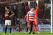 Doncaster Rovers forward Alfie Beestin (22) trys to block off Blackburn Rovers goalkeeper David Raya (1) during the EFL Sky Bet League 1 match between Doncaster Rovers and Blackburn Rovers at the Keepmoat Stadium, Doncaster, England on 24 April 2018. Picture by Mick Atkins.