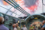 "Oct. 22, 2013. Visitors to the World War II Museum in New Orleans take in the interactive show ""FINAL MISSION: THE USS TANG EXPERIENCE,"" chronicling the epic battle that sunk the submarine and much of its crew."