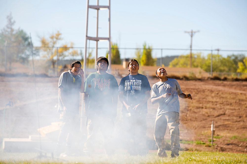 101112       Brian Leddy.Wingate Rocket Club students Colten Pine, Nathan Wilson, Jerek Begay and Trinity Charlie watch their rocket shoot into the air during a launch Thursday. The club celebrated New Mexico's 100th birthday and Native American week with the launching of a rockets, singing and dancing.
