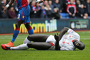 Liverpool defender Mamadou Sakho (17) gets a kick from Crystal Palace defender Pape Souare  during the Barclays Premier League match between Crystal Palace and Liverpool at Selhurst Park, London, England on 6 March 2016. Photo by Simon Davies.