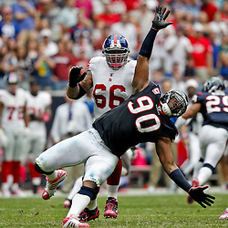 October 10, 2010; Houston, TX USA; Houston Texans defensive end Mario Williams (90) rushes past New York Giants offensive tackle David Diehl (66) during the second half at Reliant Stadium. The Giants defeated the Texans 34-10. Mandatory Credit: Derick E. Hingle