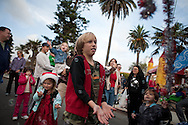 Children play among a swarm of bubbles after the 2009 La Jolla Christmas Parade.